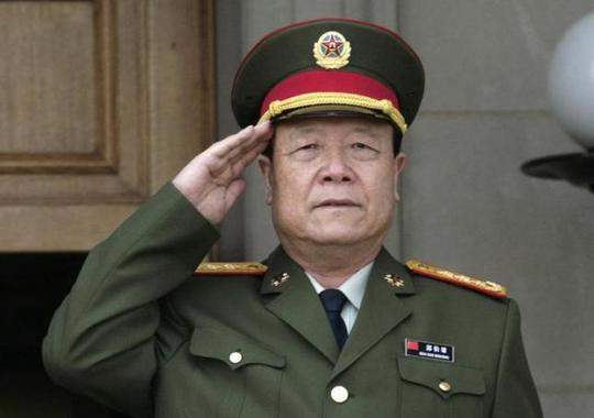 Chinas then-Central Military Commission former Vice Chairman General Guo Boxiong stands at attention during the playing of the national anthem before a meeting at the Pentagon in Washington July 18, 2006. REUTERS/Yuri Gripas