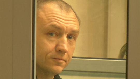 A still image from a video footage shows Estonian police officer Eston Kohver in a defendants cage during a court hearing in Pskov, Russia, June 2, 2015. REUTERS/Reuters TV