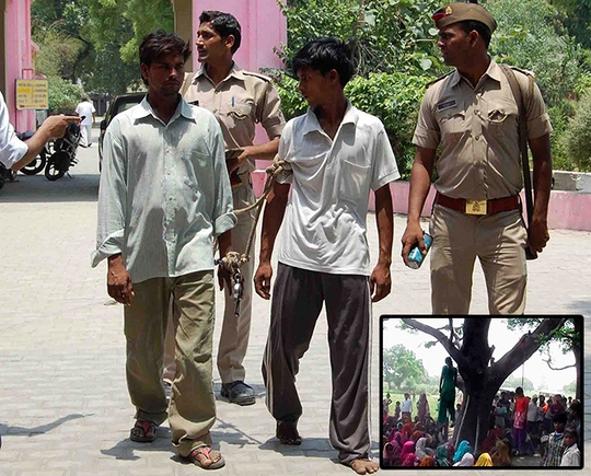 Hai nghi phạm bị cáo buộc treo cổ 2 bé gái lên cây. Ảnh: Reuters