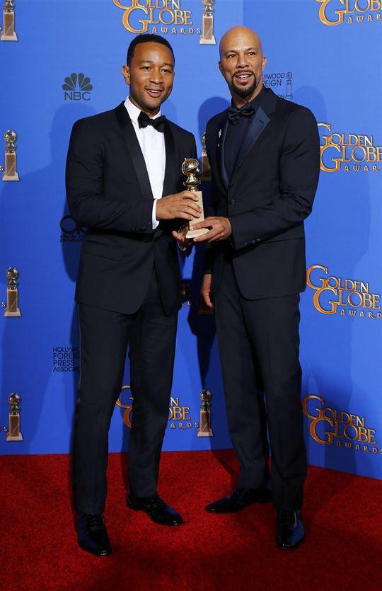 Nam ca sĩ John Legend và rapper Common chiến thắng với ca khúc Glory trong phim Selma. Ảnh: Reuters