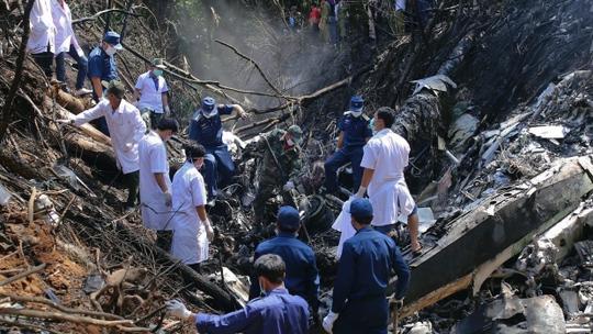 Vụ tai nạn máy bay quân sự Lào ở tỉnh Xiangkhoung vào tháng 5-2014. Ảnh: Reuters