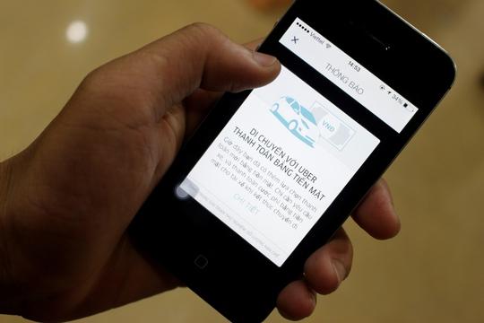 Việt Nam là quốc gia thứ 3 thế giới và đầu tiên tại Đông Nam Á được Uber thử nghiệm phương thức thanh toán bằng tiền mặt - Ảnh: Quốc Chiến