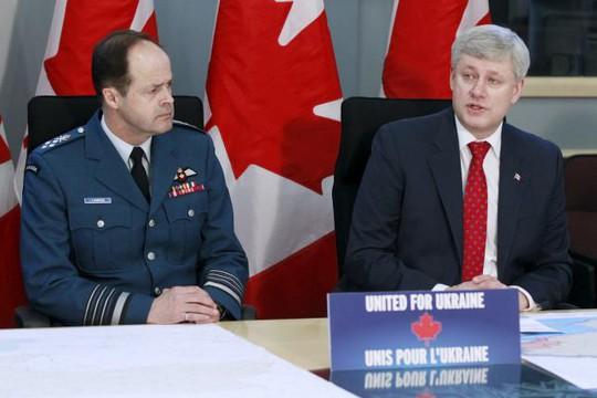 Thủ tướng Stephen Harper (phải). Ảnh :Reuters