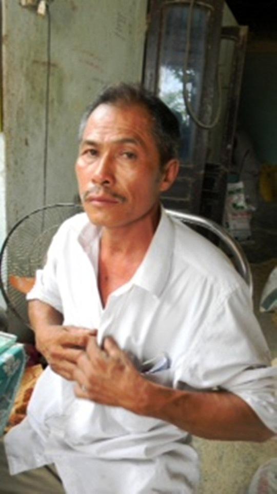 Tài xế Thanh nói rằng mình không biết ông Thạnh nằm ở sau xe khi đổ đất - Ảnh: Tam Phú