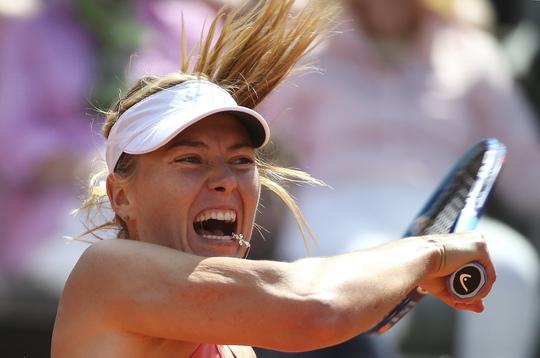 Sharapova vất vả ngược dòng trước NavarroẢnh: REUTERS