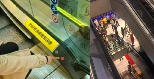 Người mẹ trẻ có thể thoát chết nếu ai đó bấm nút đỏ cho thang cuốn ngừng hoạt động. Ảnh: Weibo