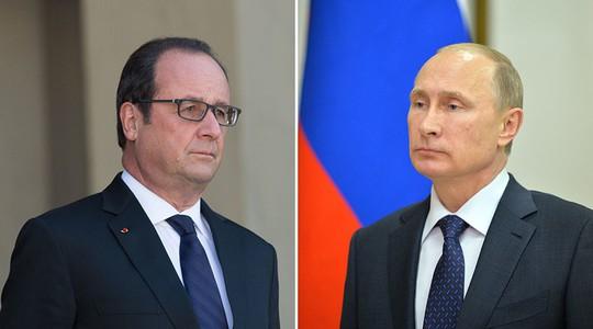 Tổng thống Putin (phải) và Tổng thống Hollande. Ảnh: REUTERS