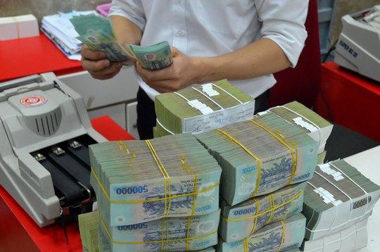Nhiều chuyên gia cho rằng cần dùng ngân sách nhà nước để xử lý nợ xấu Ảnh: TẤN THẠNH