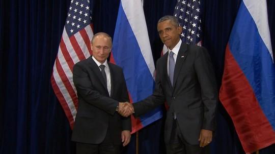 Tổng thống Nga Vladimir Putin và người đồng cấp Mỹ Barack Obama. Ảnh: ABC News