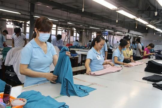 Trong xu thế hội nhập, người lao động cần phải có kỹ năng nghề để giữ việc làm Ảnh: KHÁNH AN