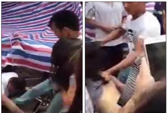 Anh ta đá tới tấp vào tình nhân của vợ bất chấp sự can ngăn của cô vợ. Ảnh cắt từ clip