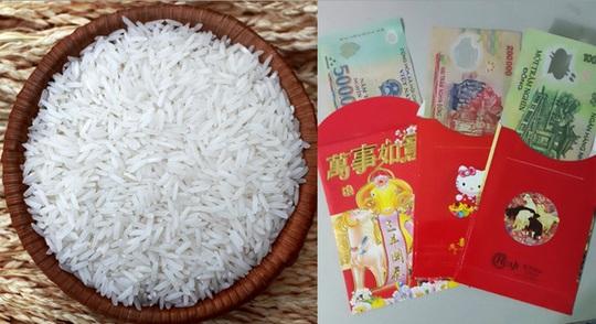 Có thể đặt một đồng tiền hoặc sợi dây đỏ, bao lì xì vào đáy hũ gạo với ý nghĩ chiêu tụ may mắn đến nhà.