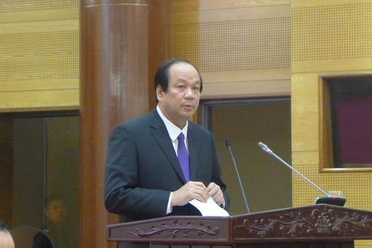 Bộ trưởng, Chủ nhiệm Văn phòng Chính phủ Mai Tiến Dũng trả lời tại họp báo Chính phủ ngày 29-12 - Ảnh: Thế Dũng