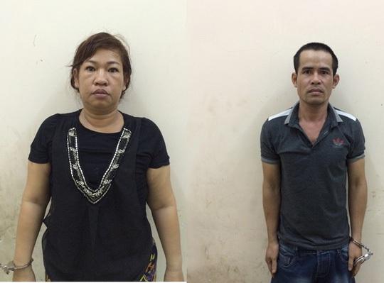 Trần Quỳnh Linh (trái) và Nguyễn Quốc Huy tại cơ quan công an.