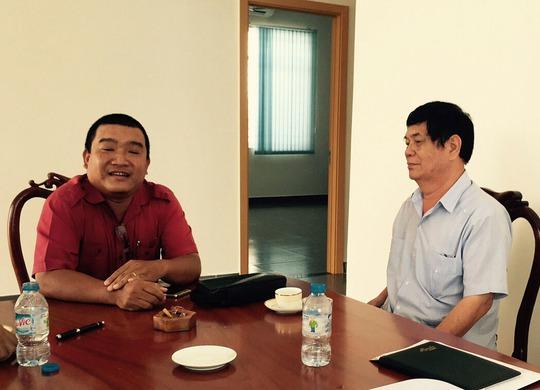 Ông Nguyễn Phong Quang (bìa phải) tại buổi tiếp xúc báo chí sáng 9-12Ảnh: Lê Khánh