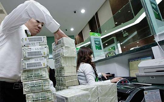 Việt Nam đang nới lỏng chính sách tiền tệ? - Ảnh 1.