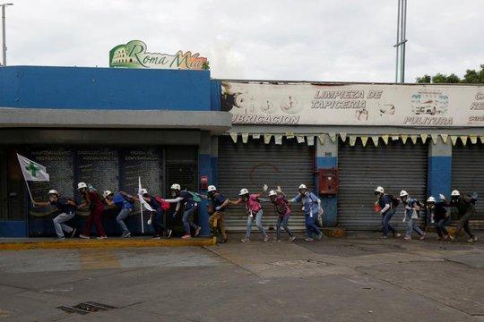 Venezuela: Bạo lực, cướp bóc gia tăng, 37 người chết - Ảnh 1.