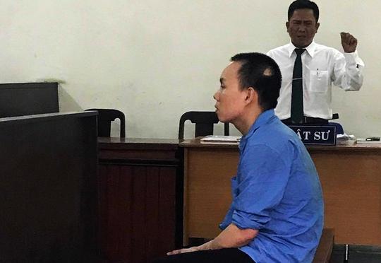 Kẻ nã súng cướp tiệm vàng ở quận Bình Tân lãnh 20 năm tù - Ảnh 1.