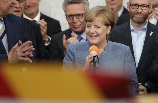 Bà Merkel tại trụ sở đảng Liên minh Dân chủ Cơ đốc giáo (CDU). Ảnh: AP