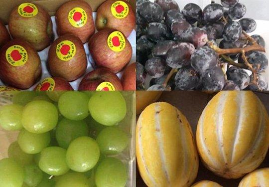 Ăn trái cây ngoại nhập: Tranh mua táo héo, nho rụng, dưa sứt vỏ - Ảnh 1.