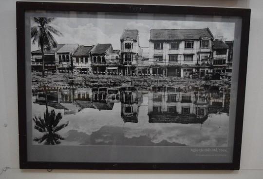 Nhiếp ảnh gia Tam Thái triển lãm ảnh Sài Gòn sau sự cố - Ảnh 1.