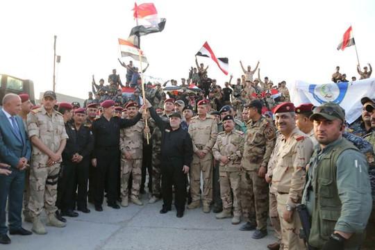 Iraq tuyên bố kết thúc cuộc chiến chống IS - Ảnh 1.