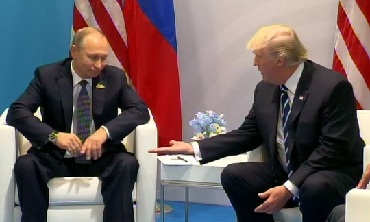 Ngôn ngữ cơ thể của tổng thống Nga - Mỹ trong cuộc họp đầu tiên - Ảnh 2.