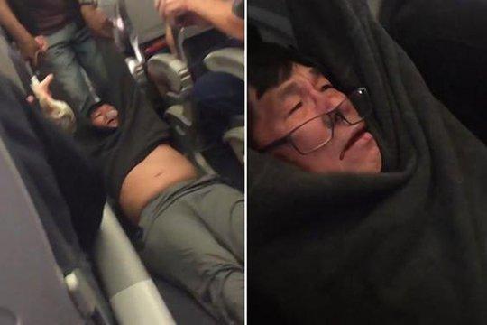 Ông Dao bị lôi khỏi máy bay hôm 9-4. Ảnh: INDEPENDENT