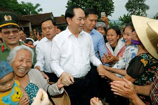 Chủ tịch nước Trần Đại Quang gặp gỡ thân mật nhân dân xã Nghĩa Đồng. Ảnh: TTXVN