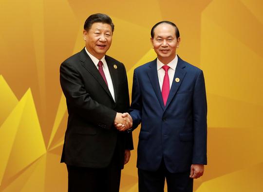 Chủ tịch nước đón Chủ tịch Trung Quốc Tập Cận Bình trước Hội nghị Cấp cao sáng 11-11. Ảnh: Reuters