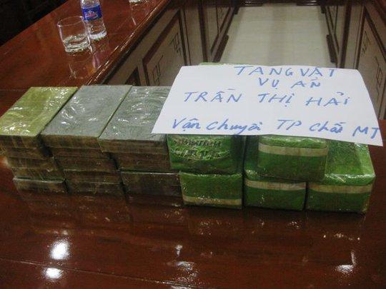 Chặn xe khách bắt người phụ nữ mang 15 bánh heroin, 5 kg ma túy đá - Ảnh 2.