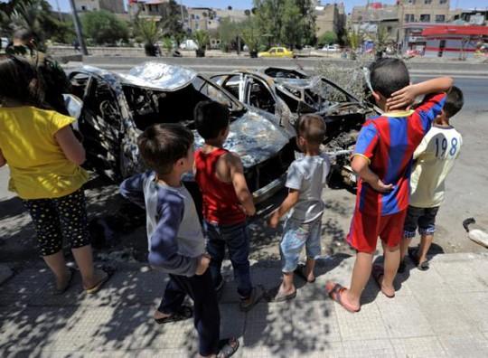 Syria in hình tổng thống Assad lên đồng nội tệ - Ảnh 3.