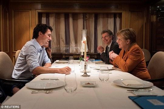 Tối 17-2, ông Trudeau đã gặp gỡ và dùng bữa tối với bà Merkel. Ảnh: Reuters.