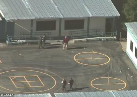 Mỹ: Xả súng từ nơi ở đến trường học - Ảnh 4.