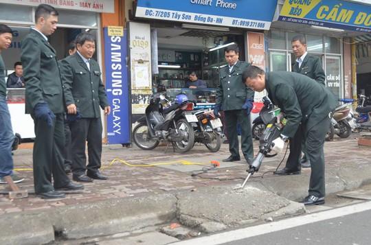 Dùng máy bắn bê-tông xử lý đường lên xuống lấn chiếm lòng đường