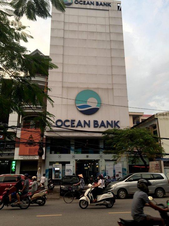Sổ tiết kiệm gần 20 khách báo lỗi: 3 cán bộ OceanBank mất tích - Ảnh 1.