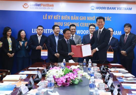LienVietPostBank bắt tay với Woori Bank Việt Nam - Ảnh 1.