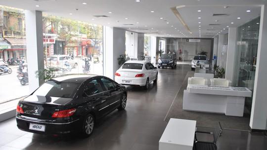 Vừa mua, ô tô đã mất giá cả trăm triệu đồng - Ảnh 1.