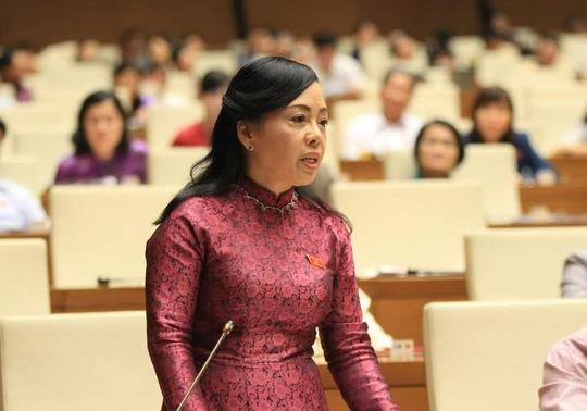 Bộ trưởng Nguyễn Thị Kim Tiến đăng đàn trả lời chất vấn - Ảnh 4.