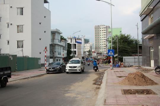 Nhờ việc cải tạo kênh Phan Văn Hân (quận Bình Thạnh) mà những căn nhà lụp xụp ven kênh đã được thay đổi bằng những ngôi nhà vững chắcẢnh: SỸ ĐÔNG