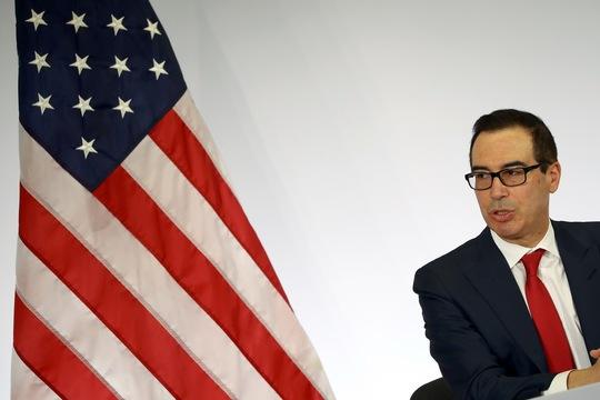 Bộ trưởng Tài chính Mỹ Steven Mnuchin phát biểu tại cuộc họp báo trong khuôn khổ hội nghị ở Baden-Baden hôm 18-3. Ảnh: Reuters