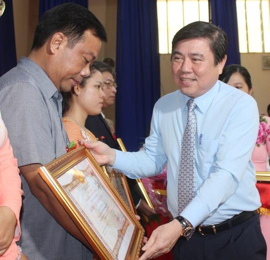Truy tặng danh hiệu cho 38 mẹ Việt Nam anh hùng - Ảnh 1.