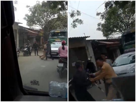 2 người đàn ông lao vào kéo CSGT để xe tải vi phạm bỏ chạy - Ảnh 1.
