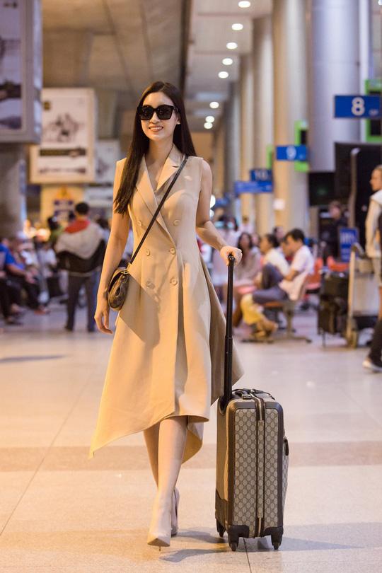 Hoa hậu Đỗ Mỹ Linh rạng rỡ ngày trở về - Ảnh 4.