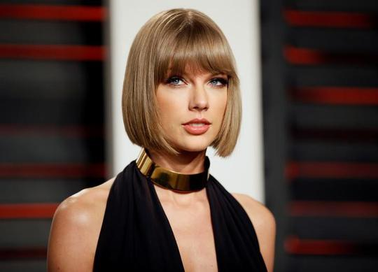 Thắng 1 USD, Taylor Swift thực hiện cam kết từ thiện - Ảnh 1.