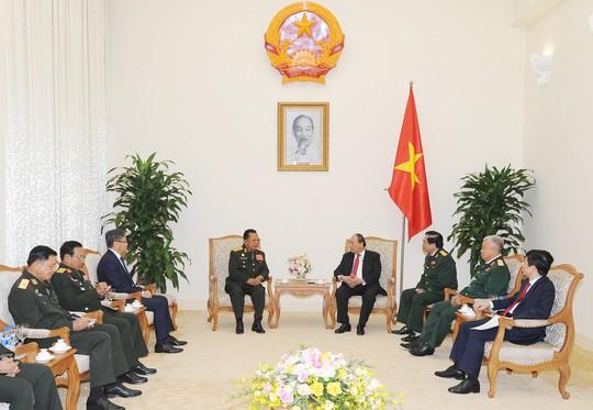 Thủ tướng Nguyễn Xuân Phúc: Việt Nam giúp Lào là giúp chính mình - Ảnh 2.