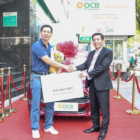 OCB trao ô tô cho khách hàng 21 năm gắn kết - Ảnh 1.
