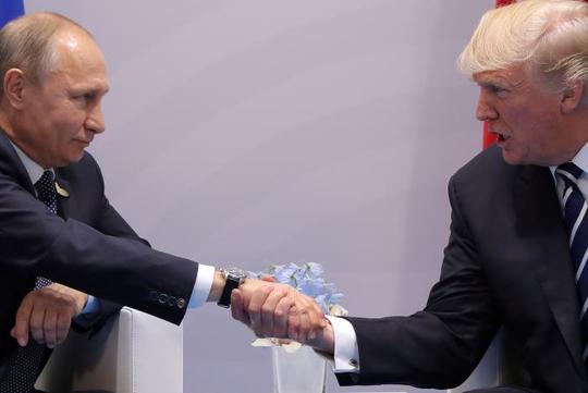 Ngôn ngữ cơ thể của tổng thống Nga - Mỹ trong cuộc họp đầu tiên - Ảnh 3.