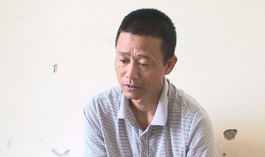 Trần Duy Thái, nghi phạm đánh vợ gãy 8 xương sườn và chấn thương sọ não, sau khi bị bắt tại cơ quan công an