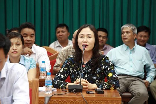 Bà Ngô Thị Minh Trinh trả lời báo chí tại buổi họp báo